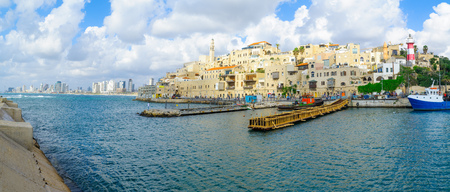 jaffa: TEL-AVIV, ISRAEL - MAY 27, 2016: Panoramic view of the Jaffa port, the old city of Jaffa, and Tel-Aviv coastal skyline, with locals and visitors, now part of Tel-Aviv Yafo, Israel Editorial