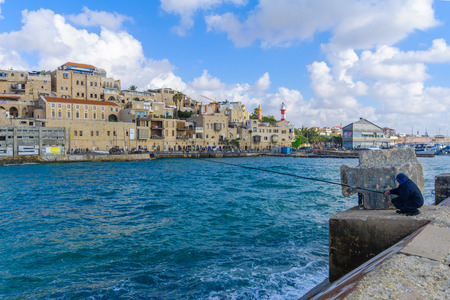yafo: TEL-AVIV, ISRAEL - MAY 27, 2016: View of the Jaffa port and of the old city of Jaffa, with locals and visitors, now part of Tel-Aviv Yafo, Israel