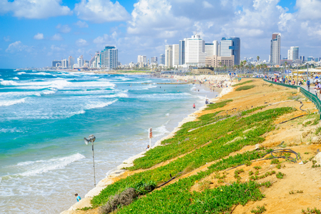 yaffo: TEL-AVIV, ISRAEL - MAY 27, 2016: View of the beach and skyline of Tel-Aviv, as viewed from Jaffa, with locals and visitors, in Tel-Aviv Yafo, Israel