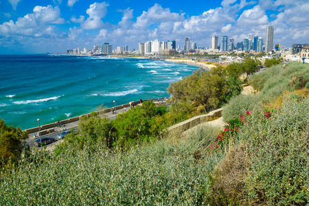 yafo: TEL-AVIV, ISRAEL - MAY 27, 2016: View of the beach and skyline of Tel-Aviv, as viewed from Jaffa, with locals and visitors, in Tel-Aviv Yafo, Israel
