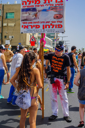 protestor: TEL-AVIV, ISRAEL - JUNE 03, 2016: A protestor against circumcision speaks to the crowd, in the Pride Parade in the streets of Tel-Aviv, Israel. Its part of an annual event of the LGBT community
