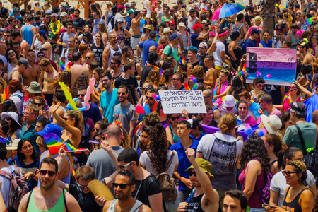 annual event: TEL-AVIV, ISRAEL - JUNE 03, 2016: A crowd of people march in the Pride Parade in the streets of Tel-Aviv, Israel. Its part of an annual event of the LGBT community Editorial