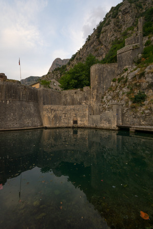 dated: The South Gate (Gurdic Gate), dated 13 century, and the old town walls, in Kotor, Montenegro Stock Photo
