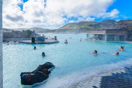 grindavik: REYKJANES, ICELAND - JUNE 21, 2016: Scene of the Blue Lagoon, with bathers, on the Reykjanes Peninsula, southwestern Iceland