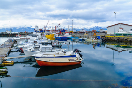 HUSAVIK, ICELAND - JUNE 17, 2016: View of the fishing harbor of Husavik, northeast Iceland