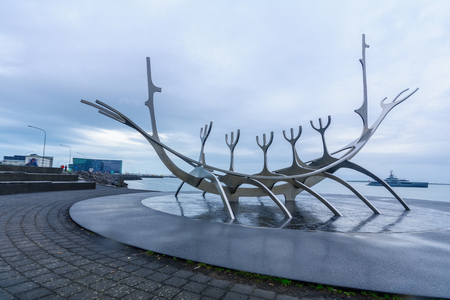 voyager: REYKJAVIK, ICELAND - JUNE 10, 2016: The Sun Voyager monument, with the Harpa in the background, in Reykjavik, Iceland