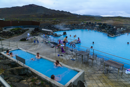 therapy geothermal: REYKJAHLID, ICELAND - JUNE 16, 2016: View of the Myvatn Naturebaths, with bathers, a geothermal hot lagoon in Northeast Iceland