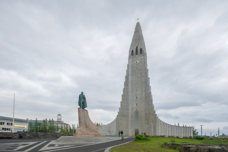 lutheran: REYKJAVIK, ICELAND - JUNE 11, 2016: View of the Hallgrimskirkja church, with visitors, in Reykjavik, Iceland Editorial