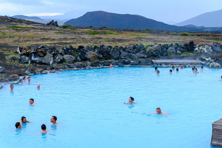 REYKJAHLID, ICELAND - JUNE 16, 2016: View of the Myvatn Naturebaths, with bathers, a geothermal hot lagoon in Northeast Iceland