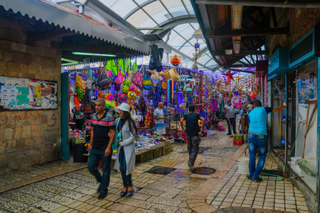 acre: ACRE, ISRAEL - AUGUST 03, 2016: Scene of the old city market, with local businesses, locals and tourists, in Acre, Israel