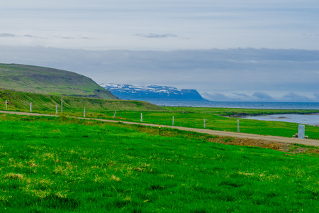 View of coastline and landscape along the Steingrimsfjordur fjord, in the west fjords region, Iceland