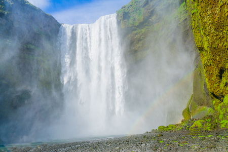skogafoss waterfall: View of the Skogafoss waterfall, with a rainbow, on the Skoga River, in south Iceland Stock Photo