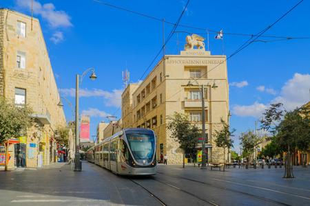 yafo: JERUSALEM, ISRAEL - SEPTEMBER 23, 2016: Scene of Yafo Street, with the Generali building, a tram, locals and visitors, in Jerusalem, Israel