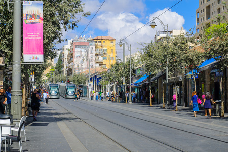 yafo: JERUSALEM, ISRAEL - SEPTEMBER 23, 2016: Scene of Yafo Street, with trams, locals and visitors, in Jerusalem, Israel Editorial