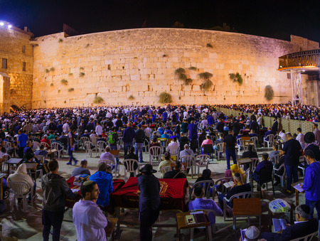 selichot: JERUSALEM, ISRAEL - SEPTEMBER 23, 2016: Scene of the western wall with a huge crowd of Selichot (Jewish penitential prays) prayers, in the old city of Jerusalem, Israel. Its an annual Jewish tradition Editorial