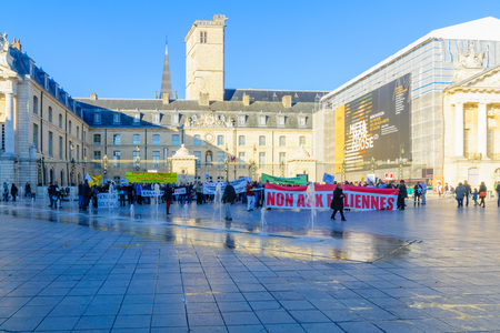 DIJON, FRANCE - OCTOBER 15, 2016: People protest against wind turbine plans, in the liberation square (place de la liberation), in Dijon, Burgundy, France