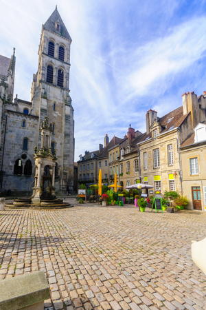 AUTUN, FRANCE - OCTOBER 16, 2016: The Saint-Lazare Fountain and cathedral, with locals and visitors, in Autun, Burgundy, France