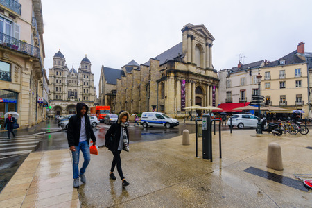 center city: DIJON, FRANCE - OCTOBER 14, 2016: Street scene in the Place du Theatre, with typical old houses, locals and visitors, in Dijon, Burgundy, France