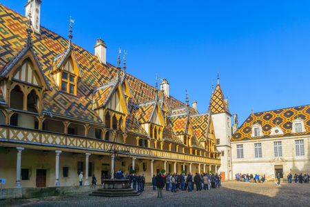 BEAUNE, FRANCE - OCTOBER 15, 2016: The Hospices of Beaune (historic hospital), with visitors, in Beaune, Burgundy, France