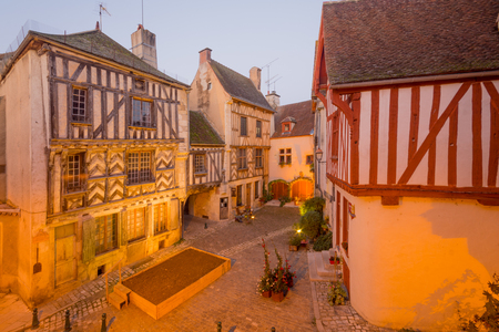 Sunrise view of a square (place de la petite etape aux vins), with half-timbered houses, in the medieval village Noyers-sur-Serein, Burgundy, France