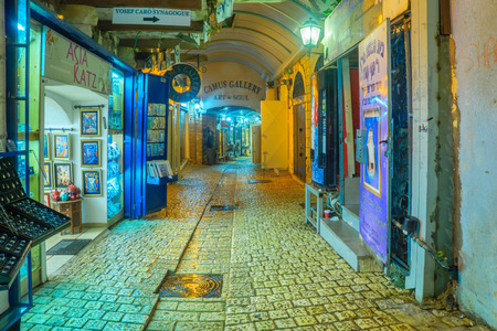 SAFED, ISRAEL - DECEMBER 26, 2016: An alley in the Jewish quarter, with local shops and galleries, in Safed (Tzfat), Israel.