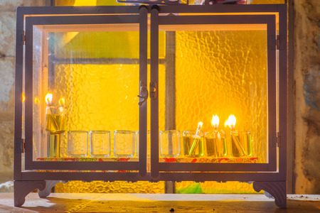 Traditional Menorah (Hanukkah Lamp) with olive oil candles, in the Jewish quarter, in Safed (Tzfat), Israel