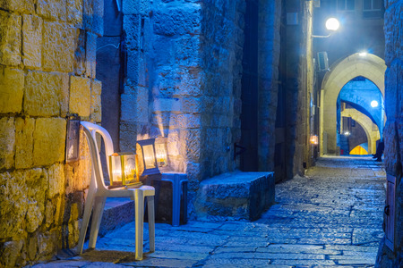 JERUSALEM, ISRAEL - DECEMBER 29, 2016: Alley with a display of Traditional Menorahs (Hanukkah Lamps) with olive oil candles, in the Jewish quarter, Jerusalem Old City, Israel