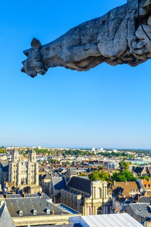 An aerial view of the historic center of the city, with a Gargoyle and the St. Michel church, in Dijon, Burgundy, France