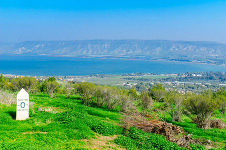 View of the southern part of the Sea of Galilee, and nearby villages, with a sign marking sea level altitude. Northern Israel