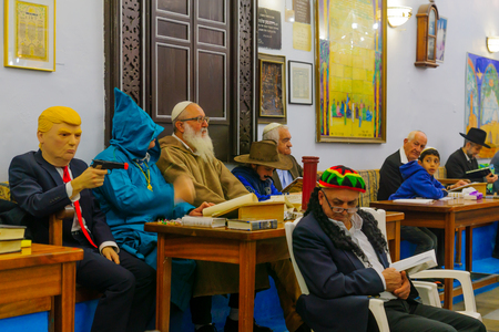 esther: SAFED, ISRAEL - MAR 11, 2017: Traditional Purim (Jewish Holiday) in the old Abuhav synagogue with prayers, some in costumes, attend a reading of the megillah (Scroll of Esther). Safed (Tzfat), Israel