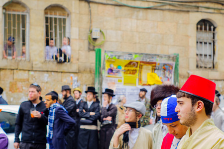 mea: JERUSALEM, ISRAEL - MARCH 13, 2017: Ultra-orthodox Jewish men, some in costumes, as part of a celebration of the Jewish Holyday Purim, in the Mea Shearim neighborhood, Jerusalem, Israel