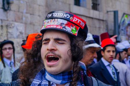 shearim: JERUSALEM, ISRAEL - MARCH 13, 2017: Ultra-orthodox Jewish men, some in costumes, as part of a celebration of the Jewish Holyday Purim, in the Mea Shearim neighborhood, Jerusalem, Israel