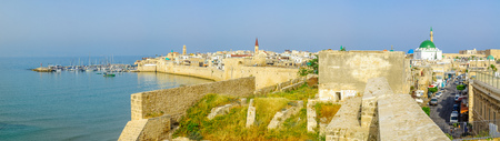 ACRE, ISRAEL - APRIL 27, 2017: Panoramic view of the city walls, the fishing harbor, business streets, the Ahmed el-Jazzar Mosque and the old city skyline, in Acre (Akko), Israel