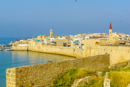 ACRE, ISRAEL - APRIL 27, 2017: View of the city walls, the fishing harbor, and the old city skyline, in Acre (Akko), Israel