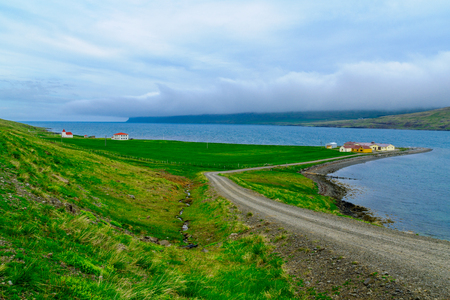 secluded: Countryside and a secluded church along the Bitrufjordur fjord, in the west fjords region, Iceland