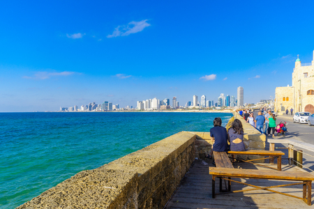 TEL-AVIV, ISRAEL - JUNE 02, 2017: View from Jaffa towards the beach and skyline of Tel-Aviv, with locals and visitors, in Tel-Aviv-Yafo, Israel