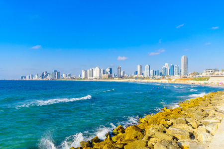 bather: TEL-AVIV, ISRAEL - JUNE 02, 2017: View of the beach and the city skyline, with bathers, in Tel-Aviv, Israel Editorial