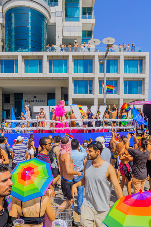 TEL-AVIV, ISRAEL - JUNE 09, 2017: Crowd and dancers on a truck take part in the annual pride parade of the LGBT community, in the streets of Tel-Aviv, Israel Editorial