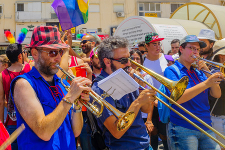 israeli: HAIFA, Israel - June 30, 2017: People play music, as part of the annual pride parade of the LGBT community, in the streets of Haifa, Israel