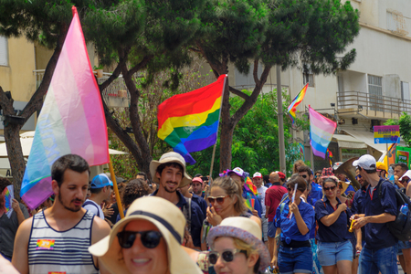 israeli: HAIFA, Israel - June 30, 2017: People march in the annual pride parade of the LGBT community, in the streets of Haifa, Israel