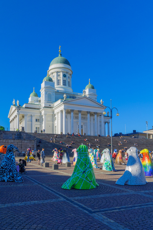 HELSINKI, FINLAND - JUNE 15, 2017: Scene of the Senate square and the Lutheran Cathedral, with a display of seal sculptures, locals and visitors, in Helsinki, Finland