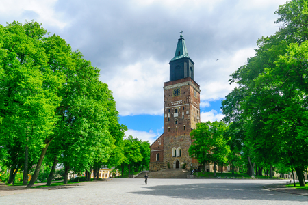 TURKU, FINLAND - JUNE 23, 2017: View of the Cathedral, with a cyclist, in Turku, Finland Editorial
