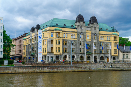 aura: TURKU, FINLAND - JUNE 23, 2017: View of the City hall and the Aura river, with locals and visitors, in Turku, Finland