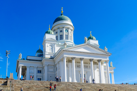 lutheran: HELSINKI, FINLAND - JUNE 16, 2017: View of the Lutheran Cathedral, with locals and visitors, in Helsinki, Finland