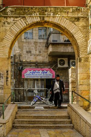 shearim: JERUSALEM, ISRAEL - JULY 12, 2017: Scene of the ultra-orthodox neighborhood Mea Shearim, with locals, in Jerusalem, Israel