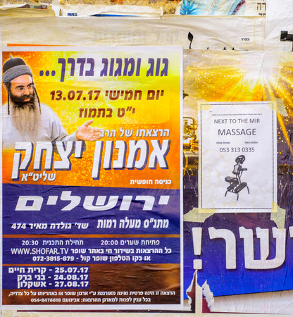 jewish community: JERUSALEM, ISRAEL - JULY 12, 2017: Combination of posters about religious preaching, and massages, in the ultra-orthodox neighborhood Mea Shearim, Jerusalem, Israel