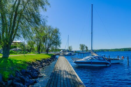 View of lake, pier and boats in Savonlinna, Finland