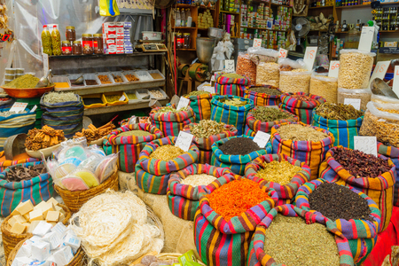 ACRE, ISRAEL - SEPTEMBER 18, 2017: Various spices in colorful sacks and other products on sale in the market, in Acre (Akko), Israel
