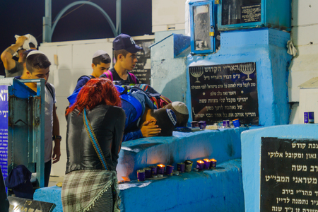 SAFED, ISRAEL - SEPTEMBER 27, 2017: Jewish people pray Selichot (penitential pray) at the tomb of The ARI (Rabbi Isaac Luria), in the old cemetery of Safed (Tzfat), Israel