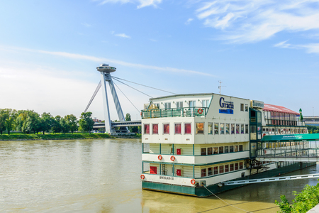 BRATISLAVA, SLOVAKIA - SEPTEMBER 25, 2013: View of the Danube River and SNP Bridge, with a floating hotel, In Bratislava, Slovakia Editorial
